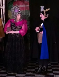Helenmary Ball (left) as Madame Frosine (disguised) and Kevin McAndrews (right) as Inspector Sansclou in The Miser at Twin Beach Players