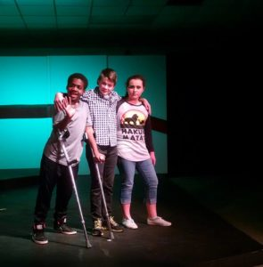 Jaylen Fontaine (left) as Archie, Pierce Elliott (center) as Evan and Grace Volpe (right) as Patrice in 13: The Musical