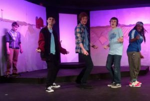 (L to R) Pierce Elliott (on the wall) as Evan, Jake Schwartz as Bret, Jake Clark as Ritchie, Aidan Slowey as Malcolm, and Maren Wright-Kerr as Eddie in 13: The Musical