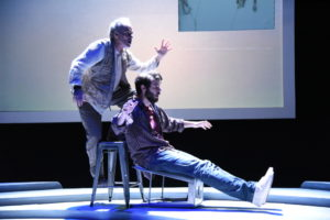 Eric Hissom (left) as Paul Watson and Thomas Keegan (right) as Dan O'Brien in The Body of an American at Theater J