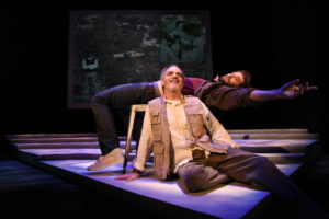 Thomas Keegan (above) as Dan O'Brien and Eric Hissom (below) as Paul Watson in The Body of An American at Theater J