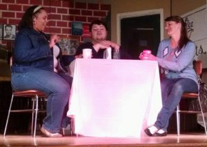 Lydia West (left) as Carley, Jason Crawford Samios-Uy (center) as Logan, and Jennifer Skarzinski (right) as Michelle in The Coffee Shop