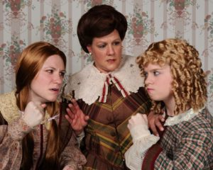 Sherry Benedek (left) as Jo, Eileen Keenan Aubele (center) as Marmee and Jennie Phelps (right) as Amy in Little Women