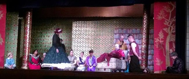 Heidi Toll (far left) as Anna and Chuck Dick (lounging right) as The King in The King & I at St. Gabriel's Miracle Players