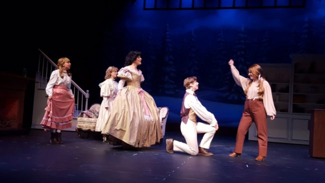 (L to R) Allison Comotto as Beth, Jennie Phelps as Amy, Amy Luchey as Meg, Gino Cardoni as Laurie, and Sherry Benedek as Jo in Little Women