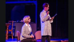 Susan Schindler (left) as Diana and David Woodward (right) as Doctor Fine in Next to Normal