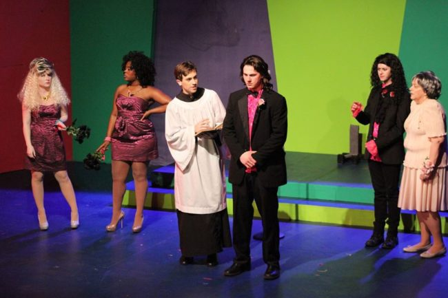 Jamie Austin Jacobs (center right) as Robbie Hart in The Wedding Singer at ASGT