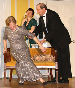 Sherry Peck (left) as Cookie Cusack, Jenn Mikulski (center) as Claire Ganz, and Ron Zyna (right) as Ernie Cusack in Rumors