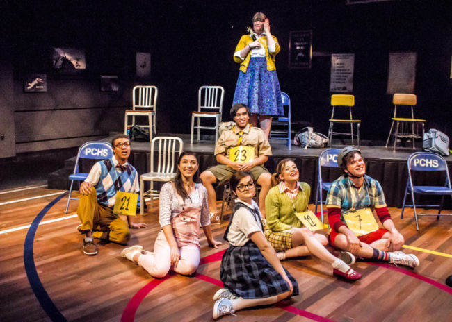 Lauren Blake Williams (back center) as Rona Lisa Peretti and The Spellers of The 25th Annual Putnam County Spelling Bee