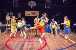 Cole Richard Watts (center) as Leaf Coneybear and the cast of The 25th Annual Putnam County Spelling Bee