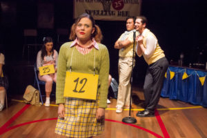 Kaity Krull (front left) as Logainne Schwartzandgrubenierre with Diego Esmolo (back left) as Carl Dad and Daniel Johnston (back right) as Dan Dad