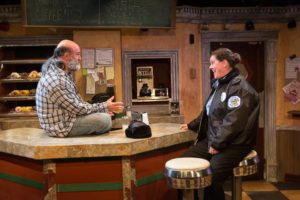 Tad Janes (left) as Arthur Przybyszewski and Laura Stark (right) as Officer Randy Osteen in Superior Donuts at the MET