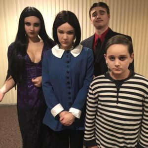 (L to R) Rachel Miller as Morticia, Kelsey Feeney as Wednesday, Nathan Beyer as Gomez, and Dylan Morrison as Pugsley in The Addams Family