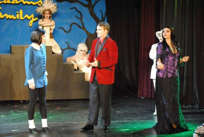 Kelsey Feeney (left) as Wednesday, Nathan Beyer (center) as Gomez and Rachel Miller (right) as Morticia in The Addams Family
