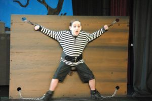 Dylan Morrison as Pugsley Addams in The Addams Family