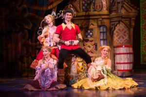 Christiaan Smith-Kotlarek (center) as Gaston and The Silly Girls in Beauty & The Beast