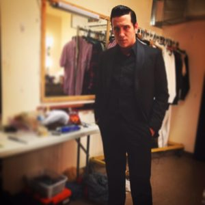 Austin Wayne Price preparing to take the stage as Johnny Cash in Million Dollar Quartet at Infinity Theatre Company