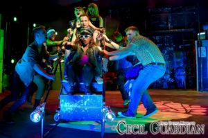 "The cast of American Idiot performing ""On Holiday"" at Milburn Stone Theatre"