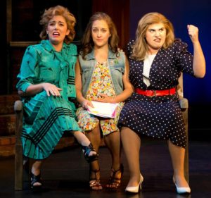 "Ana Marcu (left), Lauren Wright (center) and Emily Freeman (right) performing ""The Ladies Singing Their Song"" in Baby at Infinity Theatre Company"