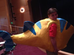 Logan Dubel as Flounder rehearsing for The Little Mermaid at Charm City Players