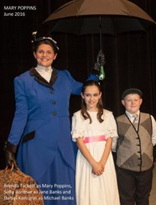 Brenda Tackett (left) as Mary Poppins with Sofia Bordner (center) as Jane and Daniel Koncurat (right) as Michael
