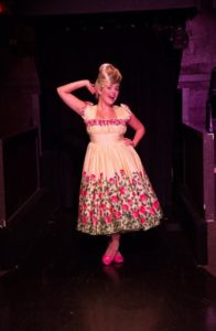 Gabriella DeLuca as Amber Von Tussle in Hairspray at Toby's Dinner Theatre