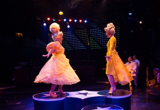 Gabriella DeLuca (left) as Amber Von Tussle and Heather Marie Beck (right) as Velma Von Tussle in Hairspray