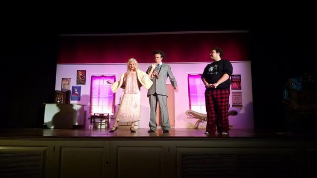 Lydia Newman (left) as Kitty, Zach Roth (center) as Feldzieg, and Jack Buzard (right) as Man in Chair