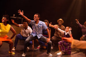 Andre Hinds (center) as Seaweed J. Stubbs in Hairspray
