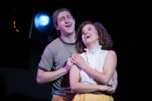 Chris Rudy (left) as Bobby Strong and Suzanne Lane (right) as Hope Cladwell in Urinetown: The Musical
