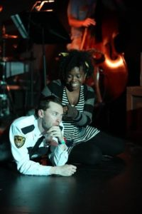 Alan Naylor (left) as Officer Lockstock and Sakile Lyles (right) as Little Sally in Urinetown: The Musical