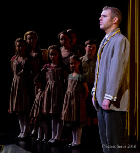 The von Trapp family singers (left) and Tyler Daniel Zeisloft (right) as Captain Georg von Trapp