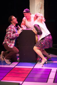 Garrett Zink (left) as Jon, Rob Wall (center) as Counter Guy and Clare Kneebone (right) as Karessa