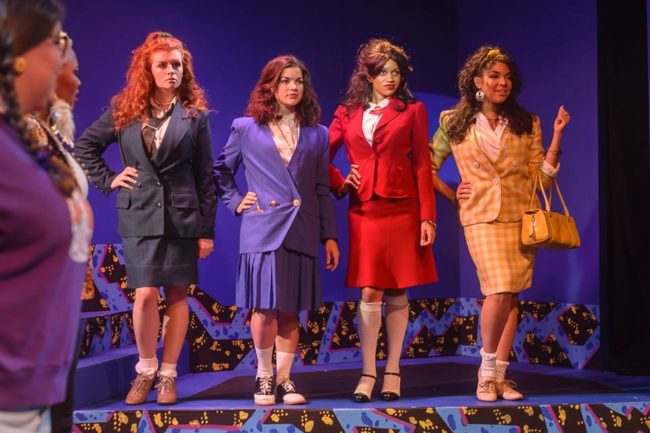 Megan Bunn (left) as Heather Duke, Tiara Whaley (center) as Heather Chandler, and Geocel Batista (right) as Heather McNamara in Heathers The Musical