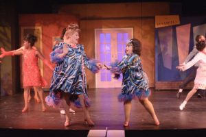 Larry Munsey (left) as Edna Turnblad and Celia Blitzer (right) as Tracy Turnblad in the 2012 Toby's Dinner Theatre of Baltimore production of Hairspray