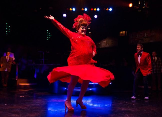 "Larry Munsey (left) as Edna Turnblad performing the big finish in ""You Cant Stop the Beat"" while David James (right) as Wilbur Turnblad watches"