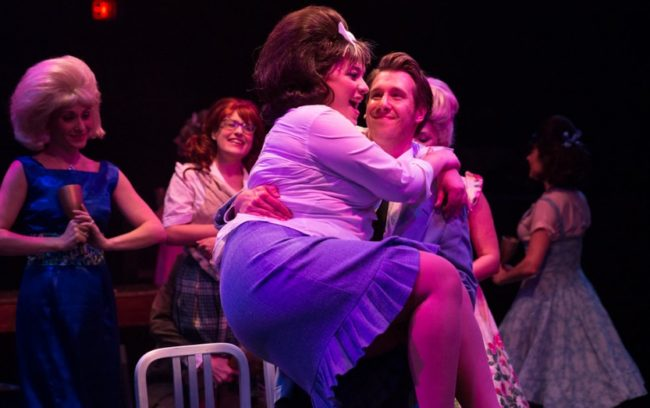 Christie Graham (foreground left) as Tracy and Justin Calhoun (foreground right) as Link with Heather Marie Beck (background left) as Velma Von Tussle and Sohpie Schulman (background center) as Penny in Hairspray