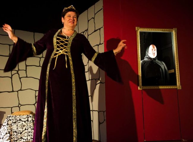 Andrea Bush (left) as The Queen and John Sheldon (right) as The Mirror in Snow White