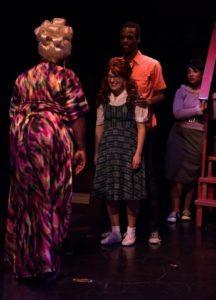 Kelli Blackwell (left) as Motor Mouth Maybelle, with Sophie Schulman (center) as Penny, Andre Hinds (right) as Seaweed and Samantha McEwen (far right) as ensemble in Hairspray