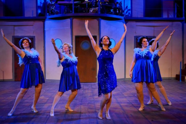 "Julie Parrish (center) as Reno Sweeney and her Angels (Laura May, Elizabeth Marion, Becky Titelman, Julie Wadey) performing ""Take Me Back to Manhattan"""