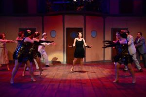 Julie Parrish (center) as Reno Sweeney in Anything Goes at Phoenix Festival Theater