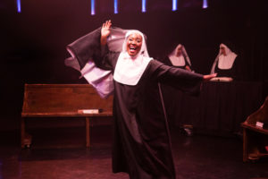 "Ashley Johnson as Sister Mary Clarence singing ""Raise Your Voice"" in Sister Act"