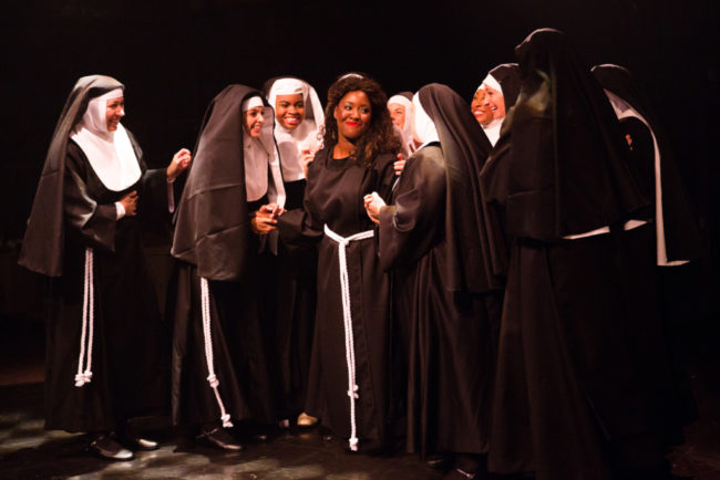 Ashley Johnson (center) as Deloris Van Cartier and her sisters in Sister Act at Toby's Dinner Theatre