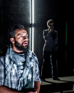 Ahmad Kamal (foreground) as Amor and Nora Achrati (background) as Supervisor in I Call My Brothers at Forum Theatre