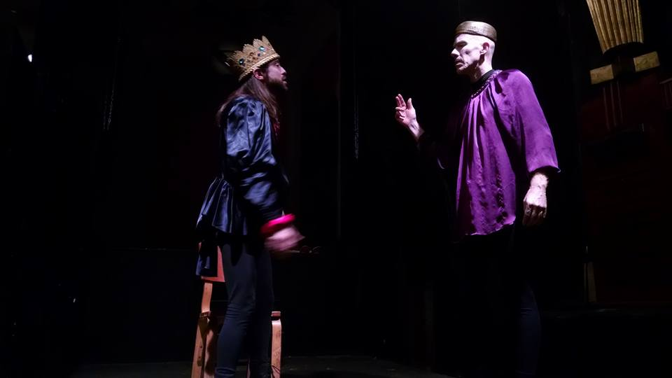 "Junius Brutus Booth (L- Scott Burke) as Richard III on the battlefield with Flynn (R- Alex Hacker) informing him of news of Richmond in ""His Majestic Lump of Foul Deformity"""