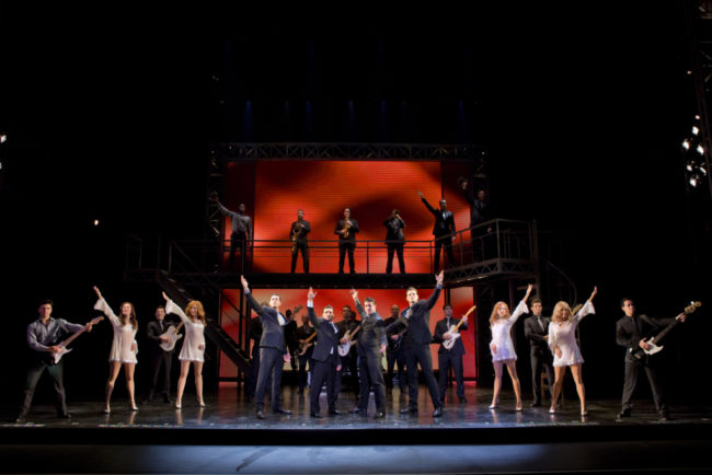 (Center: L to R) Drew Seeley as Bob Gaudio, Aaron De Jesus as Frankie Valli, Matthew Dailey as Tommy DeVito, and Keith Hines as Nick Massi, with the Company of Jersey Boys