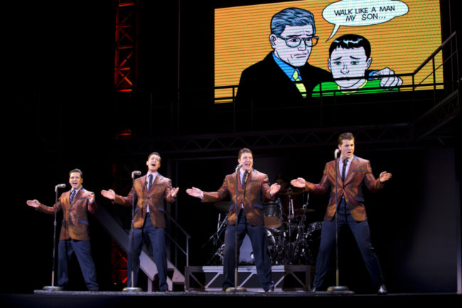 "The Four Seasons (L to R) Aaron De Jesus as Frankie Valli, Drew Seeley as Bob Gaudio, Matthew Dailey as Tommy DeVito, and Keith Hines as Nick Massi singing ""Walk Like A Man"" in Jersey Boys"