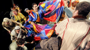 Michael Ferrante (center) as Joseph in Joseph and the Amazing Technicolor Dreamcoat