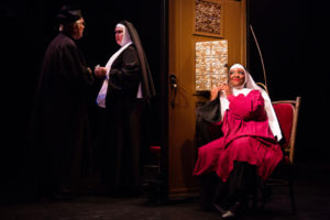 Ashley Johnson (left) as Deloris Van Cartier and Hasani Allen (right) as Sweaty Eddie in Sister Act