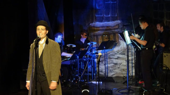 "Eric Jones as Bazzard singing ""Never the Luck"" in The Mystery of Edwin Drood"
